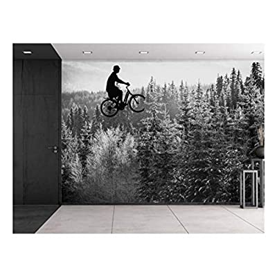 Stunning Creative Design, Created Just For You, Guy on a Bike Flying Over a Pine Tree Forest in Grayscale Wall Mural