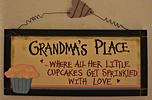 """Rustic Country Wood Plaque Sign Decoration with a Metal Wire for Hanging 12 x 5 1/2 x 3/4 Inches. Wooden Sign Saying """"Grandma's Place... Where All Her Little Cupcakes Get Sprinkled With Love"""" with Decoration Pink Sparkle Cupcake in Blue Wrapper and Black Border"""