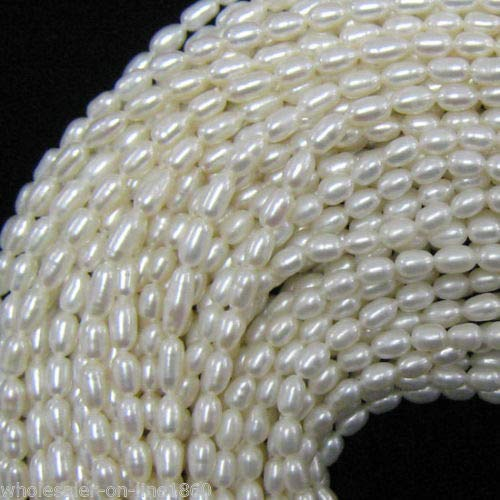 FidgetFidget 6-7mm White Freshwater Natural Rice Pearl Oval Loose Beads 15'' Strand