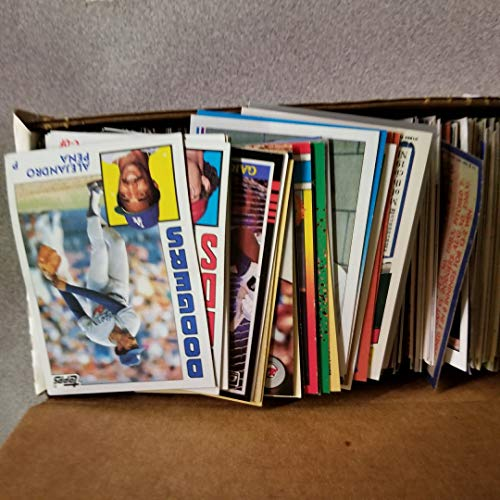 Large Product Image of 600 Baseball Cards Including Babe Ruth, Unopened Packs, Many Stars, and Hall-of-famers. Ships in Brand New White Box Perfect for Gift Giving. Includes At Least One Original Unopened Pack of Topps Vintage Baseball Cards That Is At Least 25 Years Old!