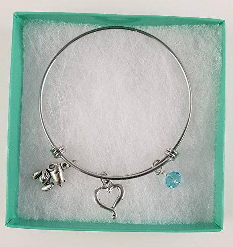 Snoopy Stainless Steel Adjustable Bangle Charm Bracelet with Open Heart and Aquamarine Blue Dangle.]()