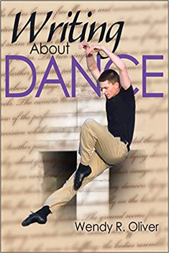 Book cover with dancing man over writing