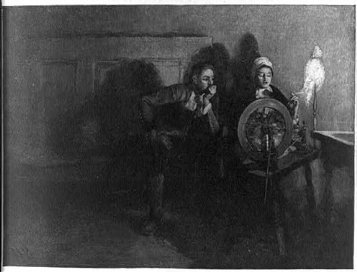 Photo: This is no courting night,Man watching woman at spinning wheel,colonial (Colonial Attire)
