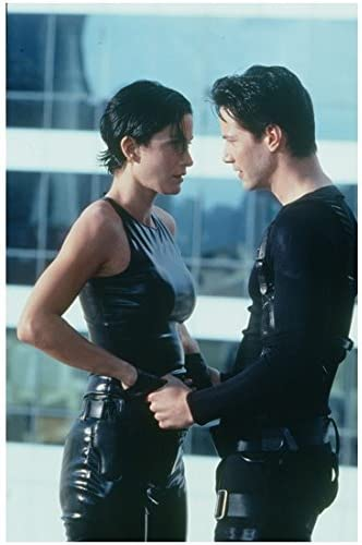 Keanu Reeves 8 Inch X 10 Inch Photograph The Matrix 1999 Wearing Black Holding Carrie Anne Moss S Hands Looking Into Her Eyes Kn At Amazon S Entertainment Collectibles Store
