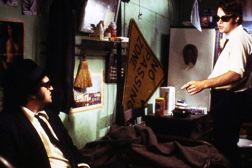 Dan Aykroyd and John Belushi in The Blues Brothers seated on bed in apartment 24x36 Poster Silverscreen