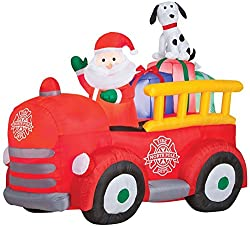 Gemmy Airblown Inflatable Santa Driving Vintage Fire Truck...