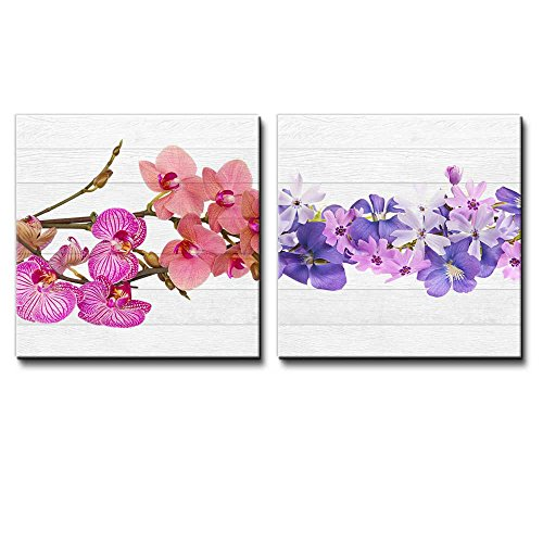 Branches of Pink and Coral Orchids Along with a Row of Purple Flowers Over White Wooden Panels