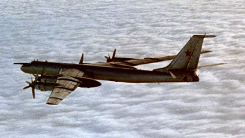 8610 Air (An air to air left side view of a Soviet Tu-142M (by NATO reporting nameBear F Mod 3) aircraft.)