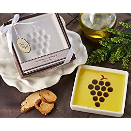 "Artisano Designs Vineyard Select Olive Balsamic Oil Vinegar Dipping Plate 1 Soft edged dish with grape shaped vinegar form provides ratio to achieve taste balance (pour olive oil first, then balsamic vinegar into shape) Vineyard themed clear covered gift box in deep red with subtle grape accented title banner Completed with white satin ribbon and bow and includes matching grape themed ""for you"" gift tag"