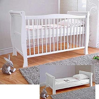 Cuna de rejilla para bebé con colchón de espuma de aloe vera y rieles dentados de altura regulable, color blanco, convertible en cama infantil