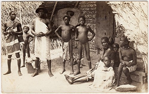 Real Photo Postcard Native Black Africans Outside of a Village - The Hut Village