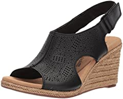 Laser-cut leather detailing, a lightweight cork wedge and easy hook and loop closure make the Lafley Rosen by Clarks Collection a versatile, ageless sandal. The delicate perforations and center seam detail on the upper add visual appeal and b...