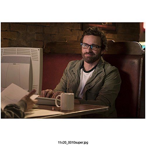 Supernatural (TV Series 2005 - ) 8 inch x10 inch Photo Rob Benedict Olive Jacket Working on Computer Seated in Red Booth kn Computer Booth