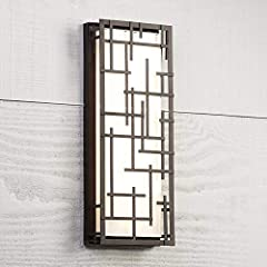 Brighten your outdoor porch or patio space with this low profile LED outdoor wall light. The large ADA compliant design features a bronze finish frame with modern lines over white cased glass. The glass is an even diffuser for the dimmable, e...