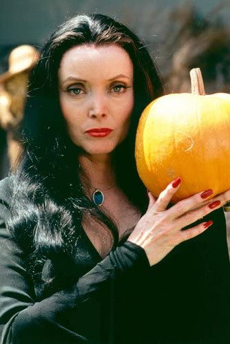 Carolyn Jones The Addams Family Color 11x17 Mini Poster Holding Pumpkin At Amazon S Entertainment Collectibles Store