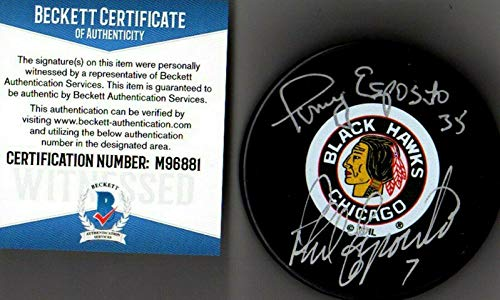 (Tony Esposito Autographed Hockey Puck - Beckett bas Phil & 6881 - Beckett Authentication - Autographed NHL Pucks )