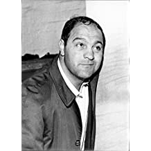 Vintage photo of Rocky Marciano smiling.