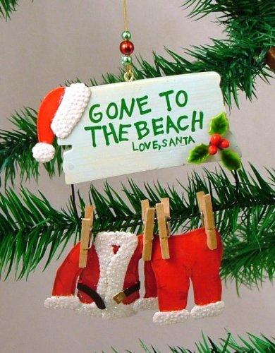 Amazon.com: Santa Claus Gone to the Beach Christmas Ornament: Home ...