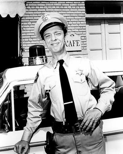 Don Knotts 16x20 Poster as Barney Fife in The Andy Griffith Show posing by police car