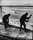 "Vintage photo of Two crew members hacks away the thick ice of ""Cimbrias"" deck after salvaging the port of Ystad"