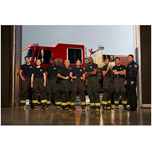 Station 19 cast standing in front of fire engine 8 x 10 Inch Photo ()