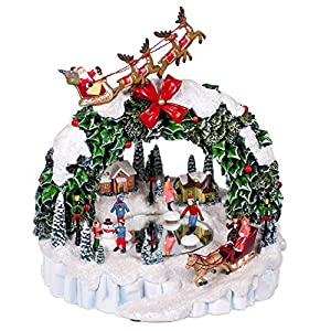 musicbox kingdom door wreath with skating scene flying santa and lighting effects as 8 different christmas melodies play decorative item