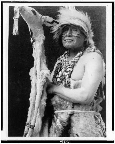 [Photo: White deerskin dance costume,Hupa Indians,ceremonial dance,clothing,Curtis,c1923] (Dance Costumes Seattle)