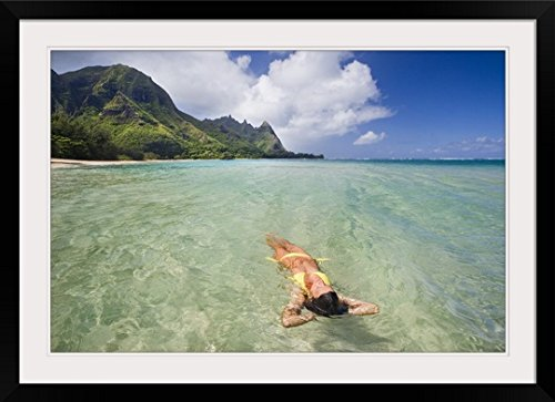 GreatBIGCanvas ''Hawaii, Kauai, Tunnels Beach, Woman Floating In The ocean'' by M Swiet Productions Photographic Print with black Frame, 36'' X 24'''' by greatBIGcanvas