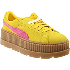 Part of the Puma x Fenty Rihanna Collection, the Cleated Creeper Suede is a fashion forward take on the classic Puma Suede. Constructed with a soft suede upper, they also feature Formstrip Puma branding, padded collar, cushioned footbed, extr...