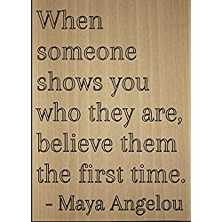 """When someone shows you who they are,..."" quote by Maya Angelou, laser engraved on wooden plaque - Size: 8""x10"""