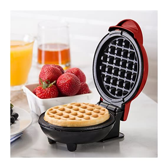 """Dash Mini Maker: The Mini Waffle Maker Machine for Individual Waffles, Paninis, Hash browns, & other on the go Breakfast, Lunch, or Snacks 3 MORE THAN WAFFLES: Make paninis, hash browns, and even biscuit pizzas! Any wet batter will """"waffle"""" your treats and snacks into single serving portions. Great for kids or on the go! COMPACT + LIGHTWEIGHT: Weighing 1lb+, this is a MUST-HAVE for that first apartment, smaller kitchen, college dorm life, or camper/RV traveling QUICK + EASY: Simply plug it in and go; it heats up in mere minutes. The dual non-stick surfaces provide an even cook for consistent results, each and every time"""
