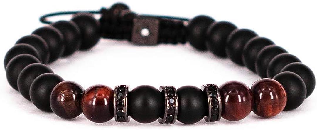 Pulsera con cordón ajustable de piedras semipreciosas. Cuentas esféricas negras y marrones y detalles en circonita negra.