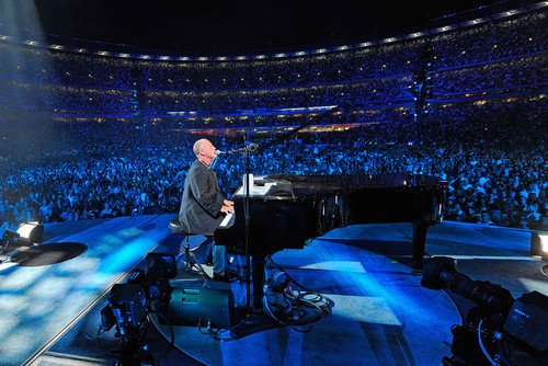 Billy Joel playing piano on stage with audience surrounding concert 24x36 Poster by Silverscreen