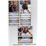 2011 12 Upper Deck Boston Bruins Veteran Team Set In Protective Storage Album - 16 NHL Trading Cards with- Tyler Seguin, Milan Lucic, Zdeno Chara, Tuukka Rask, Tim Thomas, Horton, Seidenberg, Bergeron and More