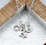 All of our products are lead free, nickel free, and hypoallergenic. This customized Rx necklace is personalized with a (3/8'') initial disc and (6mm) Swarovski birthstone of your choice! Perfect gift for any doctor or medical student! The necklace...