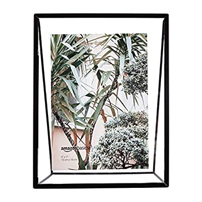 AmazonBasics Wedge Floating Photo Frame for 5 x 7 Inch Photos - Slim Frame, Black - Wedge-shaped floating frame for displaying photographs, art, and more Includes two glass panes, back, and base for floating photos or prints Display on a shelf, mantle, or desk, or give as a gift - picture-frames, bedroom-decor, bedroom - 51sAtD%2BZC7L. SS400  -