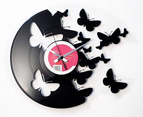 reloj de pared con mariposas y vinilo