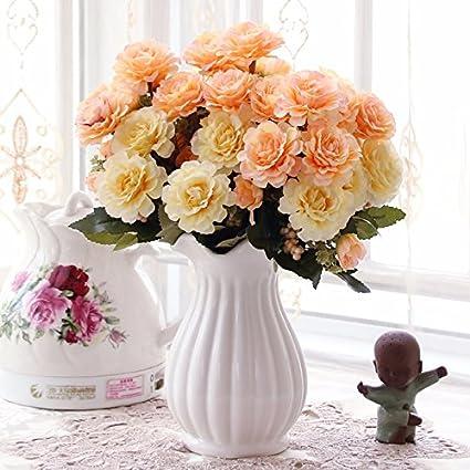 Emulación flor flores rosas en la sala de estar y una mesa de comedor juego de