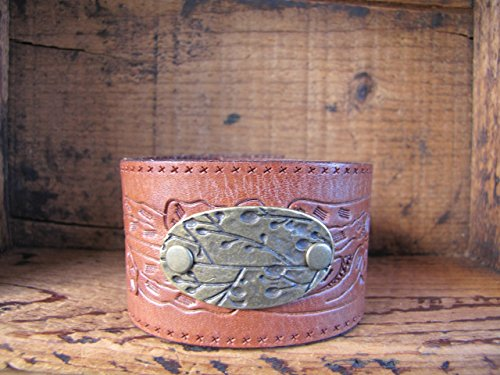 upcycled-leather-cuff-bracelet-riveted-with-branch-medallion