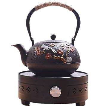 1.2L tetera + 1300W estufa de cerámica eléctrica olla de hierro fundido japonés caldera negro: Amazon.es: Jardín