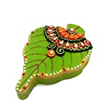This colourful handmade Betel Leaf shaped handcrafted kundan container is made of wood. The lid of the container is decorated with kundan on wooden base which is painted yellow. There is also a transparent mirror on the lid to keep it closed ...