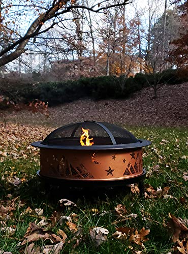 """Catalina Creations AD366 26"""" Round Copper Colored Accented Cauldron, Black - STURDY ELEGANCE: 14"""" Deep x 26"""" Diameter Made with dependable sturdy metal - perfect for larger fires. Comes with three """"4"""" Legs - weighs 8. 8 lbs. ATTRACTIVE DESIGN: This large fire pit has copper colored accent - a welcome addition to any backyard, patio, or porch. FIRE SAFETY: Fire pit includes mesh spark screen with a decorative lip A handle for added safety and beauty - the screen lifting tool provides safe and easy access during a fire. - patio, outdoor-decor, fire-pits-outdoor-fireplaces - 51sL6I7AdJL -"""