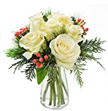 KaBloom Holiday Collection: Noel White Roses Accented with Red Berries and Seasonal Greens with Vase