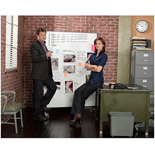 nathan-fillion-by-white-board-with-stana-katic-on-desk-castle-tv-8-x-10-inch-photo