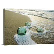 "Mary Van de Ven Premium Thick-Wrap Canvas Wall Art Print entitled Three Glass Fishing Floats Roll On The Sandy Shoreline With Ripples Of Water And Seafoam 48""x32"""