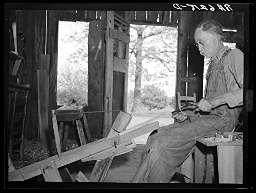 Photo Workshop Missouri - William Stamper, age eighty two, shaving oak sticks for chair braces in his workshop. Lake of the Ozarks passover area, Missouri