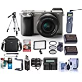 Sony Alpha A6000 Mirrorless Camera with 16-50mm E-Mount Lens, Graphite - Bundle With 64GB SDHC Card, Camera Case, 2x Spare Battery, Tripod, 40.5 Filter Kit, Video Light, Software Package, And More