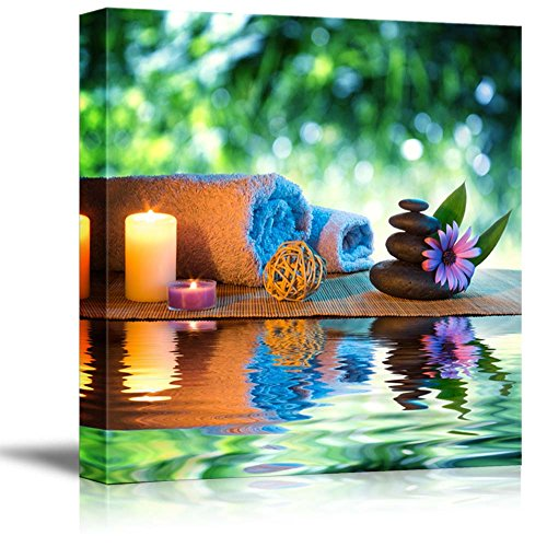 Two Candles and Towels with Black Zen Stones and Purple Daisy on Water Spa Meditation Concept Wall Decor