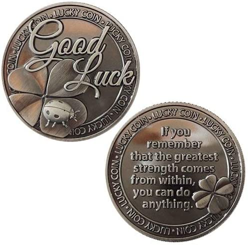 This is an image of two coins with engraved Good Luck message.