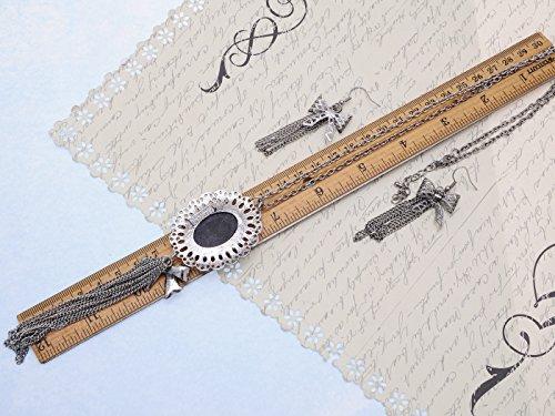 Design sophistiqué avec nœud noir Cameo Lady Maiden Collier Boucle d'oreille argenté